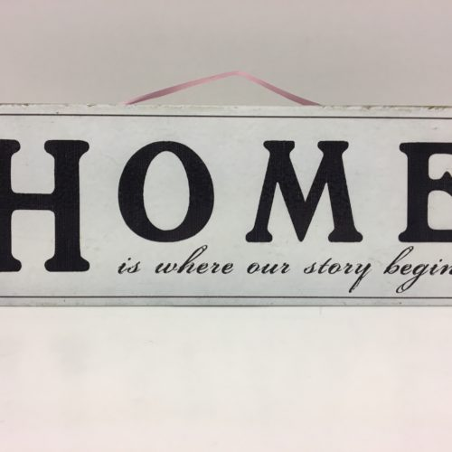 Tekstbord HOME is where our story begins