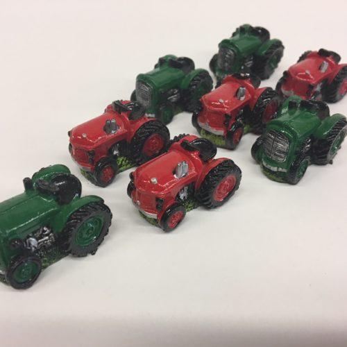 Spel boter kaas en eieren met rode en groene tractoren