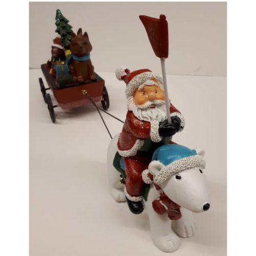 Kerstman op ijsbeer met volle kar en kerstboom
