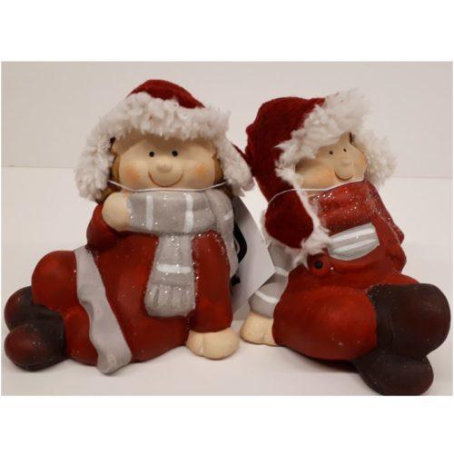 Set van 2 popjes kerstkinderen in winter kleding 9 cm