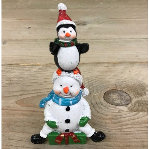 Klein beeldje sneeuwman en pinguin met kerst muts