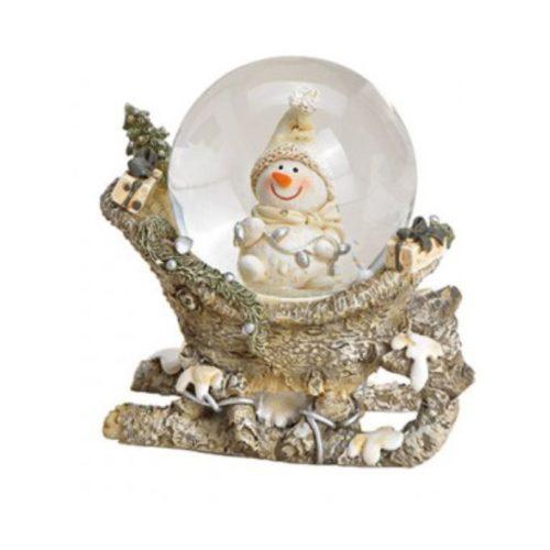 Sneeuwbol nostalgische sneeuwman op slee
