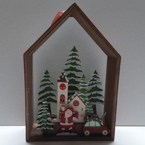 Kerst decoratie houten huis met kerstman in winters tafereel