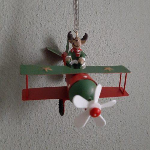 Springveer kerst-rendier in vliegtuig